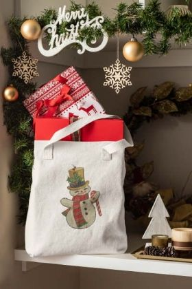 Featuring a tote bag placed on a shelf near some christmas decorations