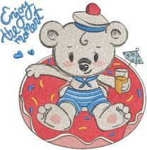 Teddy bear resting in the pool embroidery design