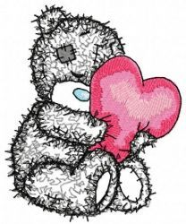 Teddy bear with a pillow in the form of heart applique