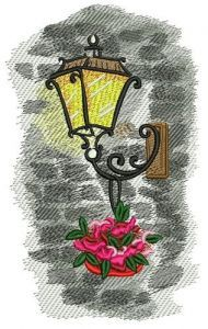 Lantern on stone wall embroidery design