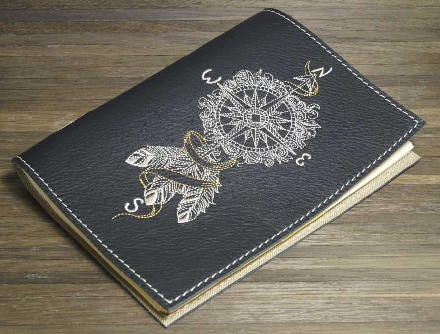 Embroidered cover with dreamcatcher compass design