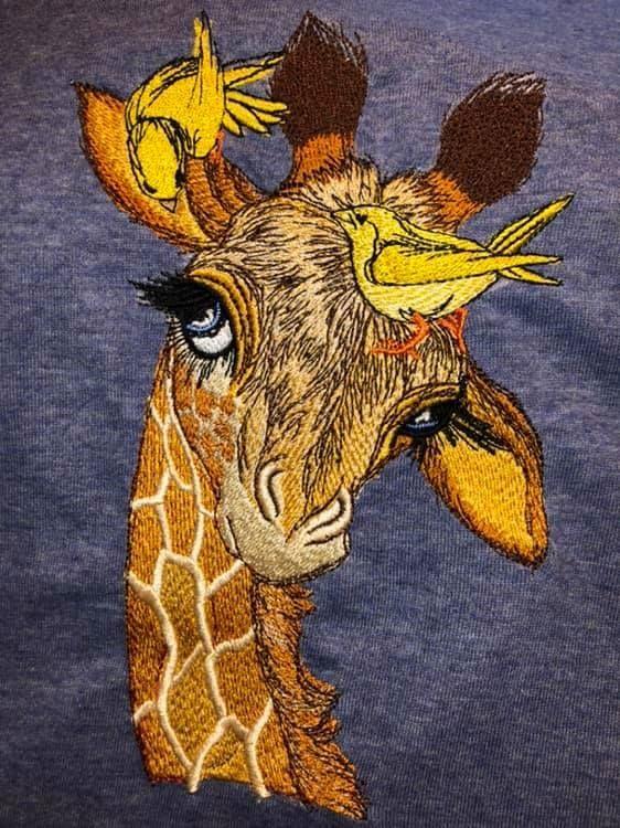Embroidered giraffe with birdies design